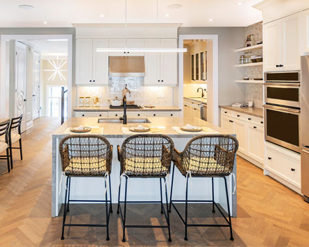 Single family home interior kitchen. Open concept, large windows and modern finishes.