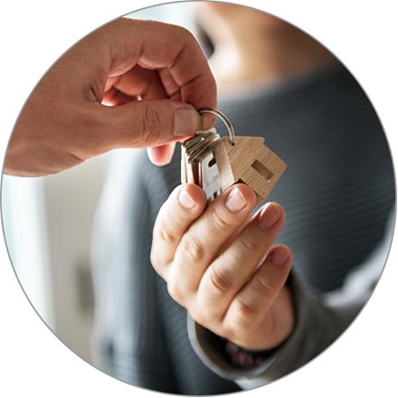 A couple accepts the keys to their new home.