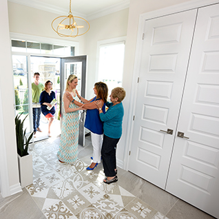 Greeting guests at the front of a Marquette home