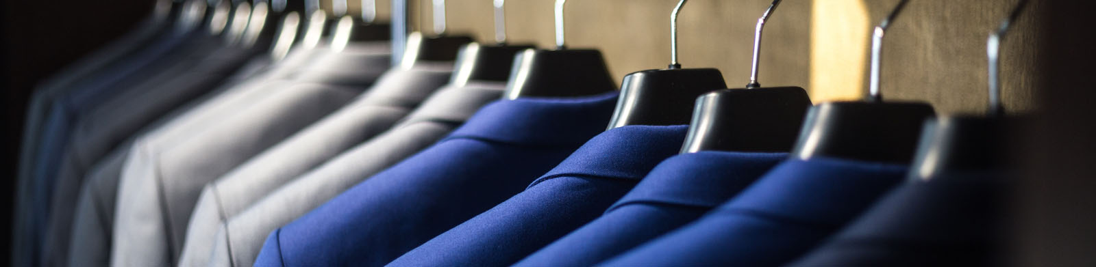 Rack of suits hanging up. Improving yourself. What you can do to find the Next You.