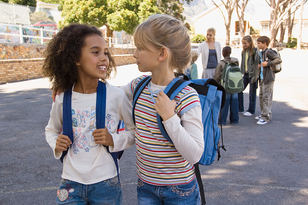 Two girls walking to school. Finding the right school in Barrhaven.