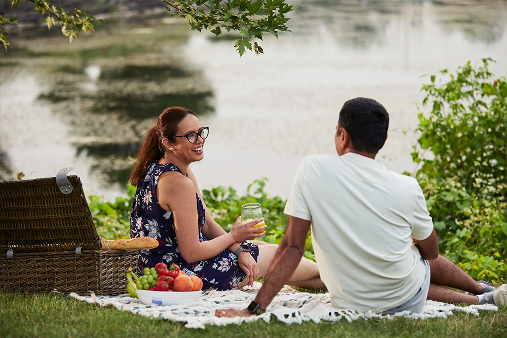 Family having picnic in park, Kanata