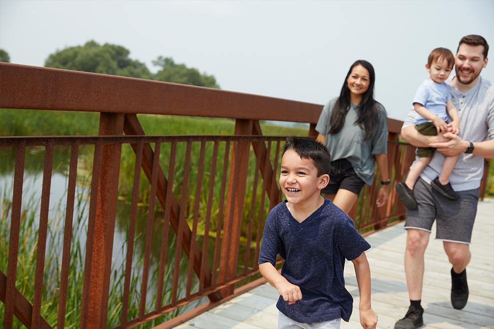 Family crossing bridge