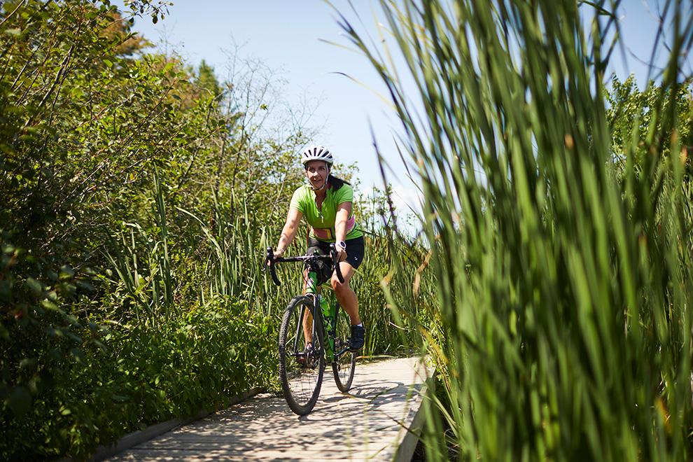 A woman riding a bike through South March
