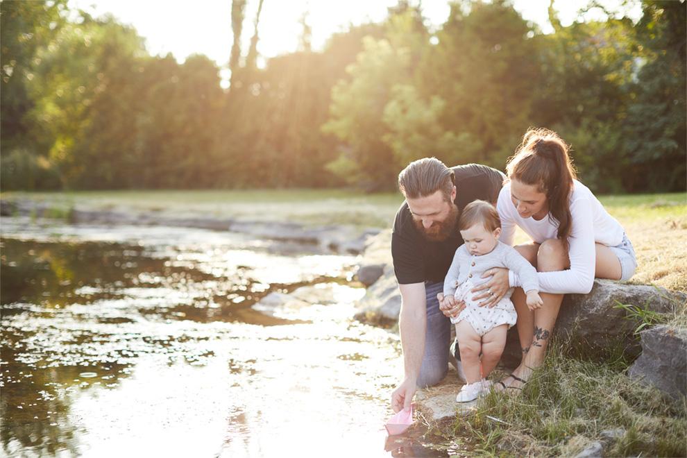 Family playing in Shirley's Brook near Brookline, Kanata