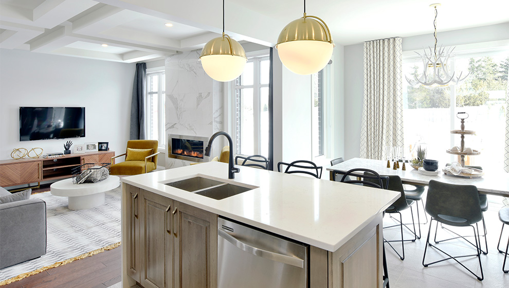 Kitchen island and living room of townhome in Ottawa. How to choose the Mahogany home that is right for you, Minto Communities.
