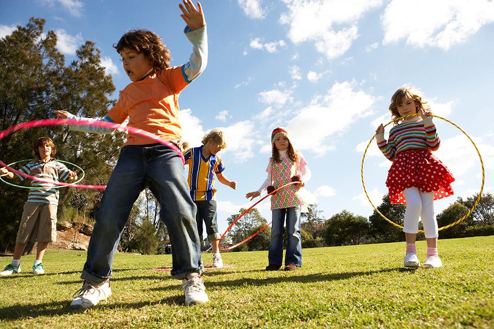 Kids playing with hoola-hoops. Schools in Manotick near Mahogany.