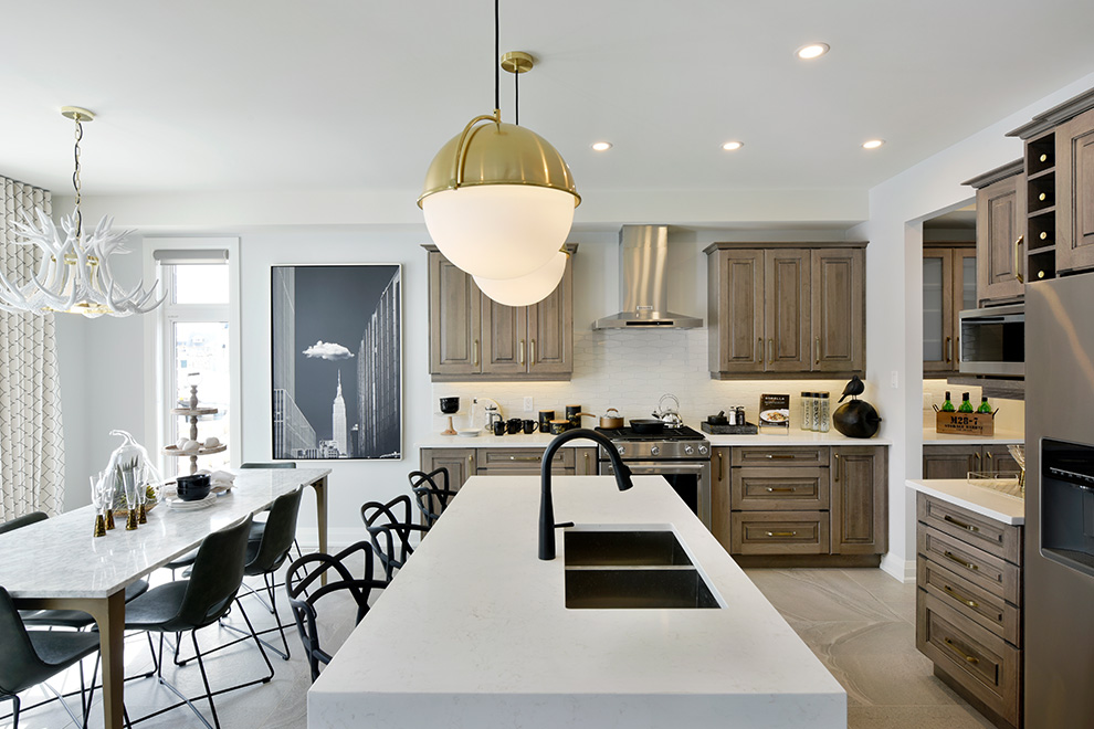 The brightly-lit open-concept kitchen of the Elderberry Single Family Home.