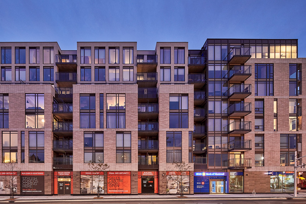 A full-width shot of the Minto Beechwood condominium taken in the evening.