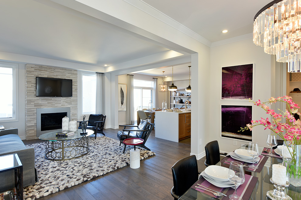 An interior shot of the Fitzroy Single Family Model Home shows off the great room and adjoining eat-in kitchen.