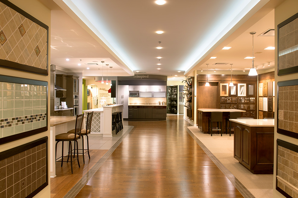 Inside the Minto Design Centre with samples of tiles, cupboard doors, islands and kitchen counters on display.