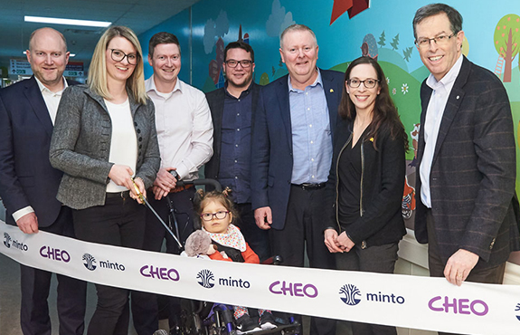 The Ryan family with Minto and CHEO management at the ribbon cutting for the Minto Way hallway dedication