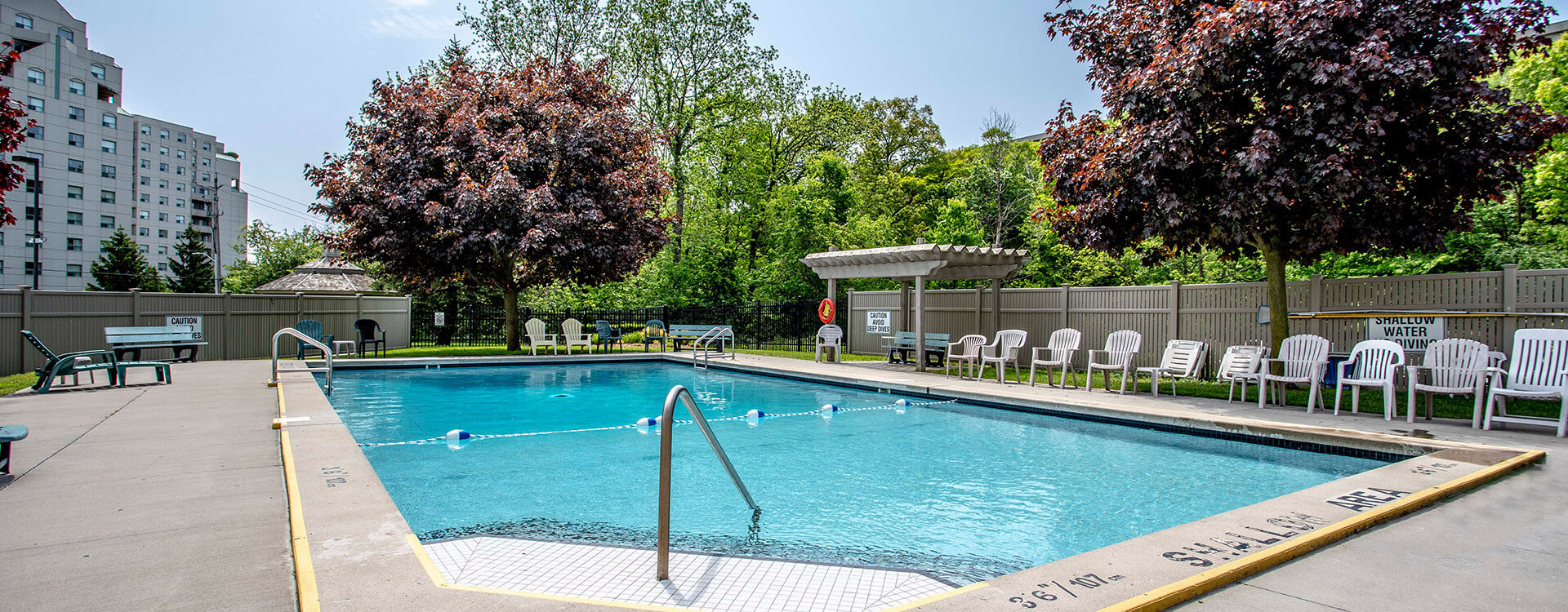 Outdoor swimming pool at Proudfoot Lane Apartments in London. Rent with Minto Apartments.