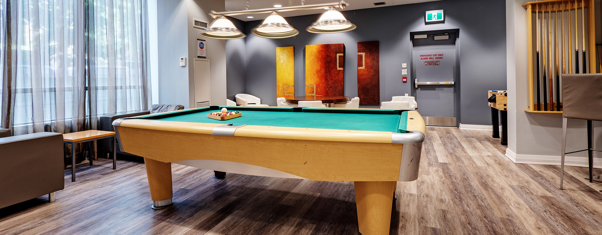 Pool room at Roehampton furnished suites in Toronto. Rent with Minto Apartments.