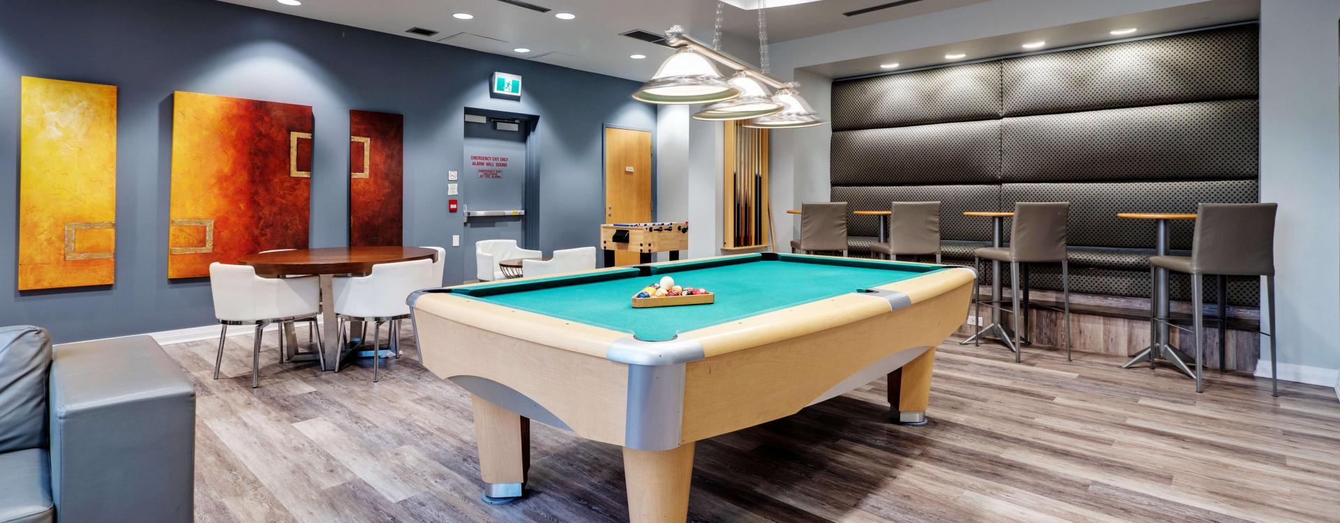 Party room with billiard at Roehampton Apartments in Toronto. Rent with Minto Apartments.