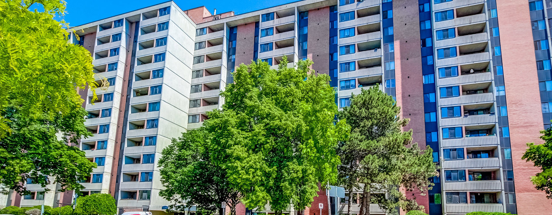 Exterior of Marlborough Court Apartments in Toronto. Rent with Minto Apartments.