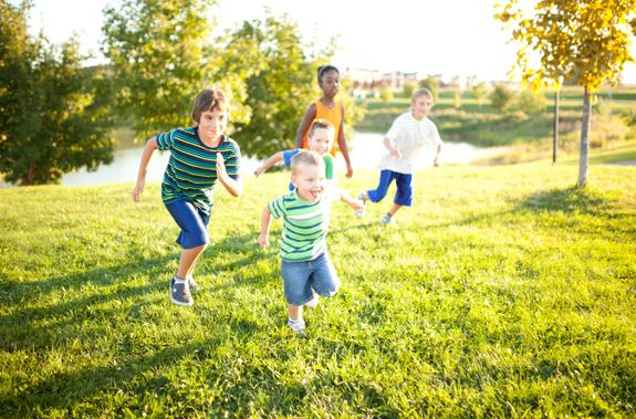 Kids playing in the park. Avalon: a community for all life stages.
