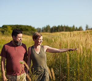 Couple Walking near Avalon Vista pond, Homes For Sale in Orleans Ottawa by Minto Communities