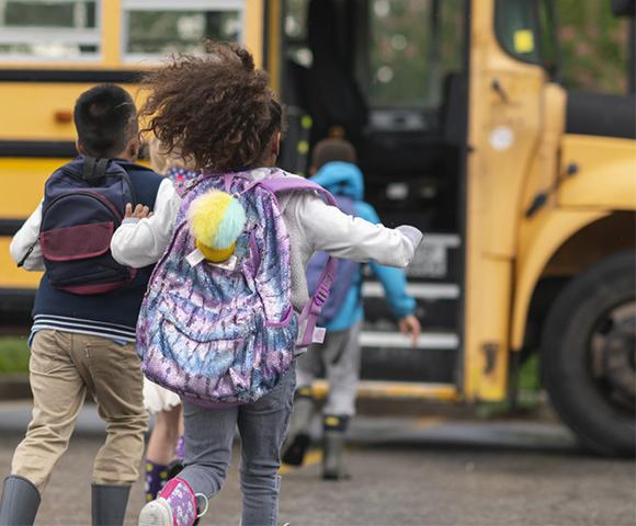 Child running to school bus in Barrhaven