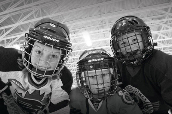 Young hockey kids posing for a picture at the Minto Recreational Complex. Things to do in Barrhaven.