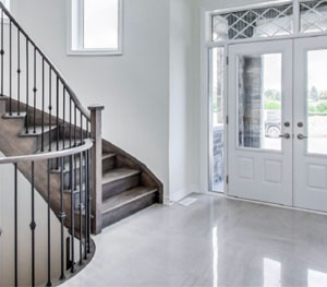 Single family home in Whitby. A staircase and front door is pictured.