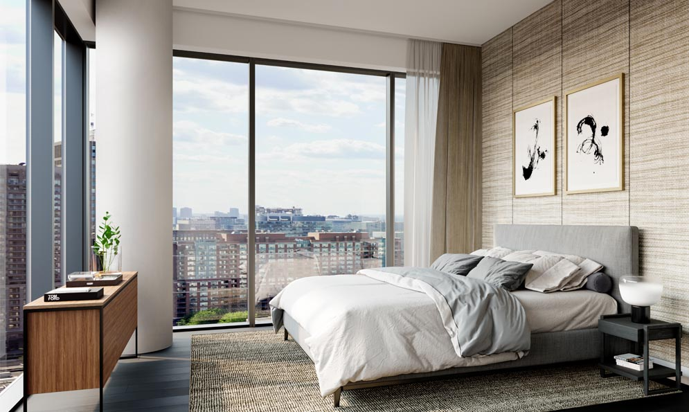 Bedroom with large windows at The Saint. New condo building at Church & Adelaide, Toronto. Minto Communities.