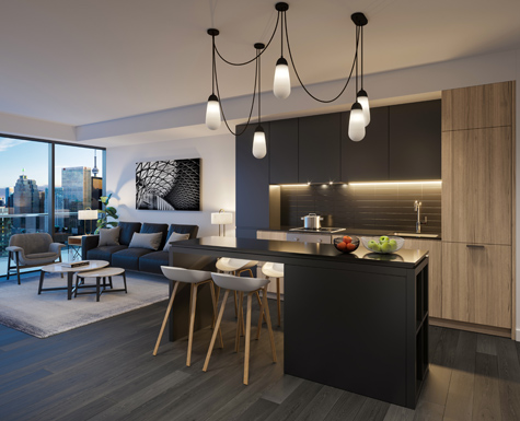 Kitchen and living area of a suite at The Saint. New condos for sale at Church & Adelaide, Toronto. Minto Communities.