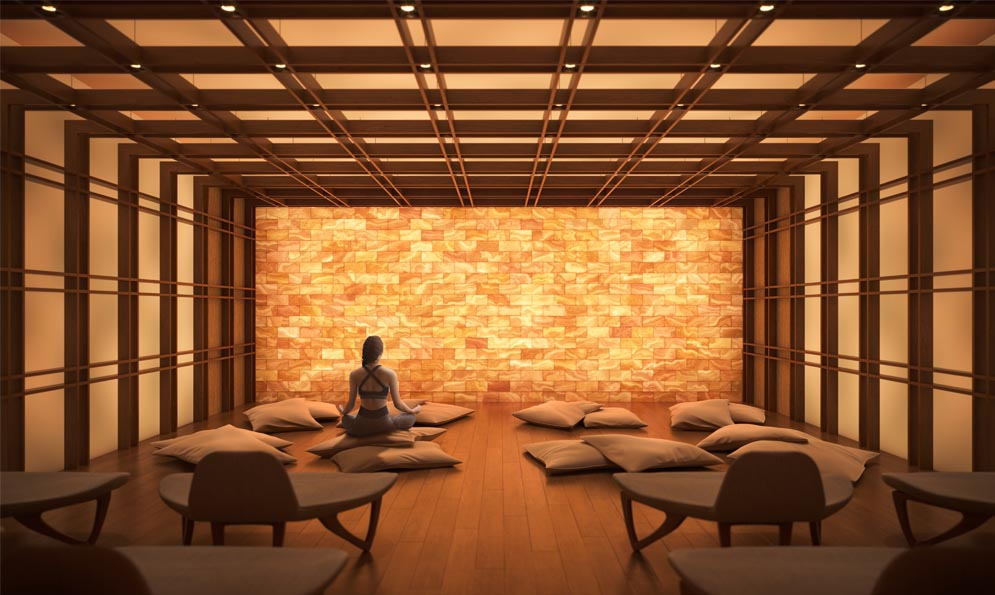 A woman meditating in the salt room at The Saint. New condo building at Church & Adelaide, Toronto. Minto Communities.