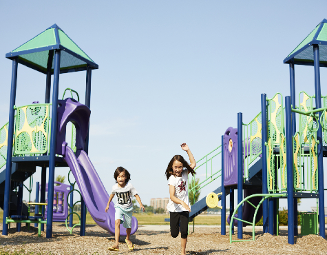 Children playing in Kanata neighborhood park. New homes for sale in Ottawa, Arcadia by Minto Communities.