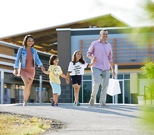 Family Walking in Tanger Outlet near Arcadia, Homes For Sale in Kanata Ottawa by Minto Communities
