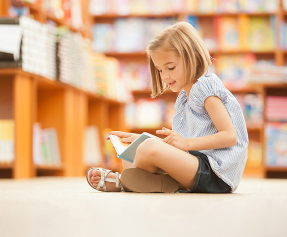 Child reading in a school in Manotick