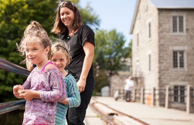 Mother and daughters on a bridge in Manotick Village. 9 Great Reason to Live in Manotick.