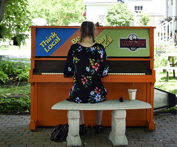 Woman playing piano in Manotick