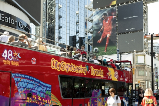 Toronto City sightseeing bus. New condos for sale at Church & Adelaide. The Saint by Minto Communities