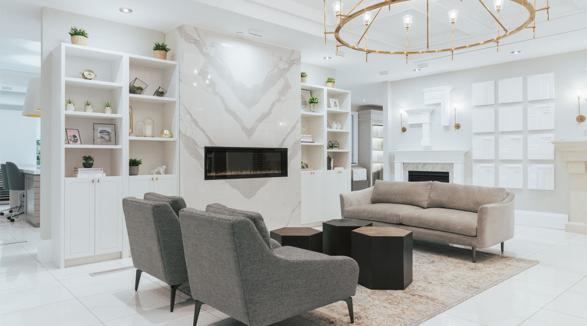 A family living room with a marble fireplace.