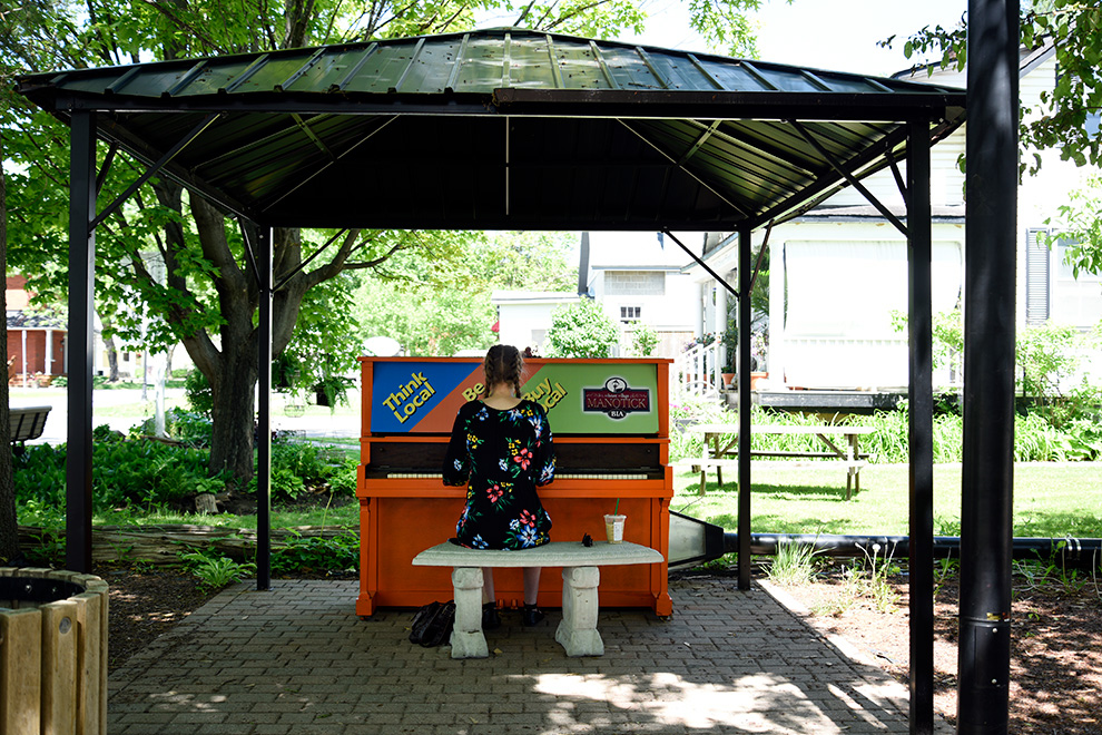 Girl playing music in Manotick Village - near Mahogany, Manotick a community by Minto Communities