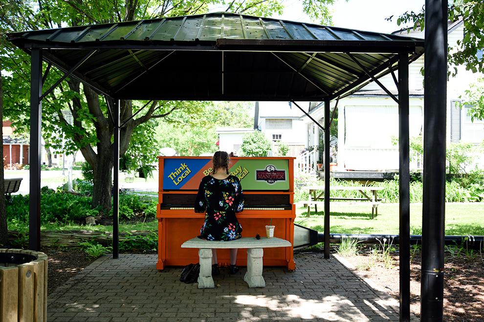 Girl playing music in Manotick Village - near Mahogany, Manotick a community by Minto Communities