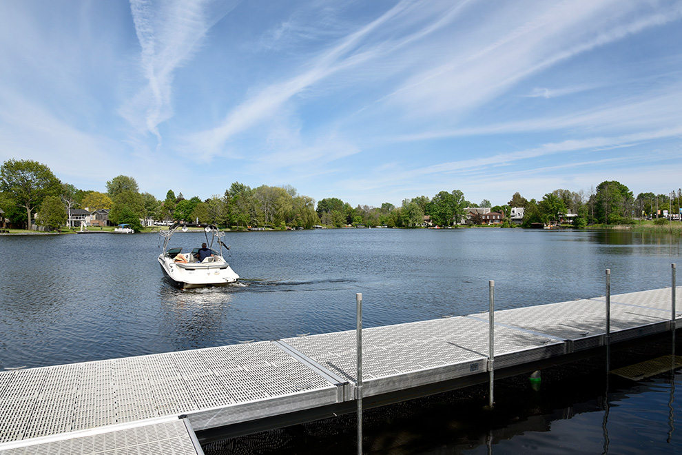 Man using a boat in lake in Mahogany, Manotick - a community by Minto Communities