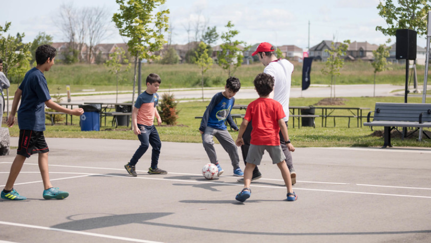 Kids playing soccer in Avalon, Orleans - a community by Minto Communities