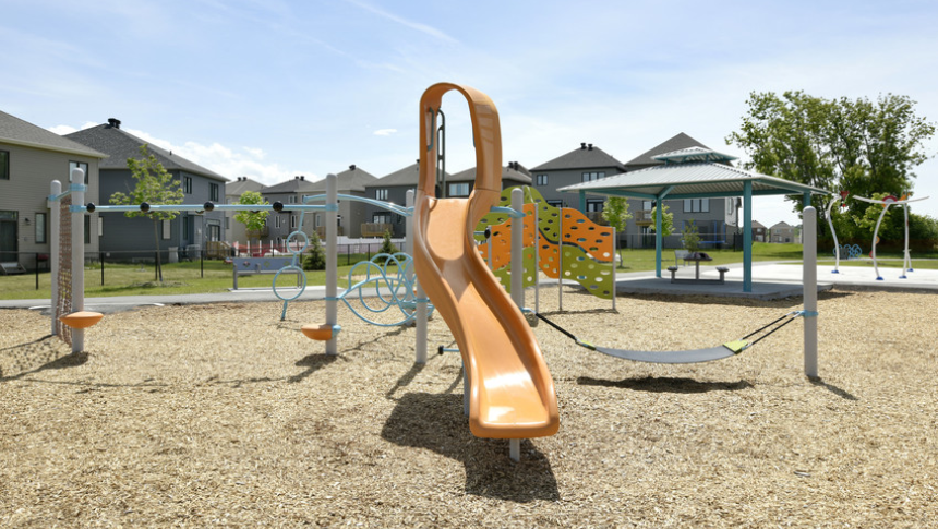 Slide in play structure in Quinn's Pointe, Barhaven - a community by Minto Communities