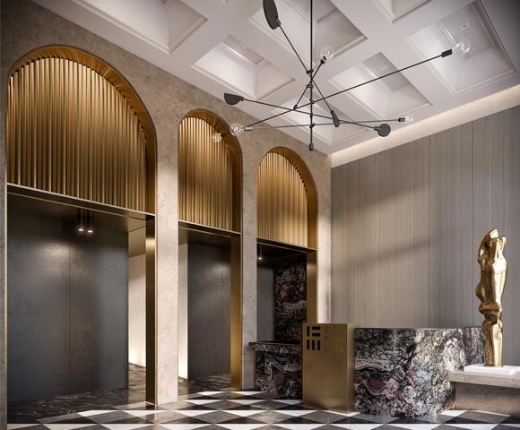 Lustrous marble and metal detailing on the reception desk creates a dramatic centrepiece