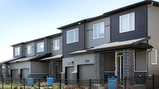 Exterior photograph of townhome model homes in Quinn's Pointe, Barrhaven