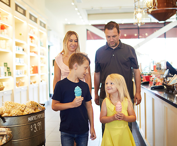 Family getting ice cream inside a shop in Orleans, Ottawa
