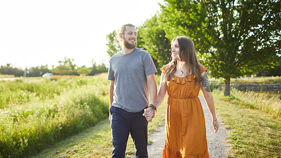 Couple walking near Shirley's Brook in Kanata, Ontario