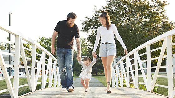 Family walking across a bridge in Kanata, Ontario