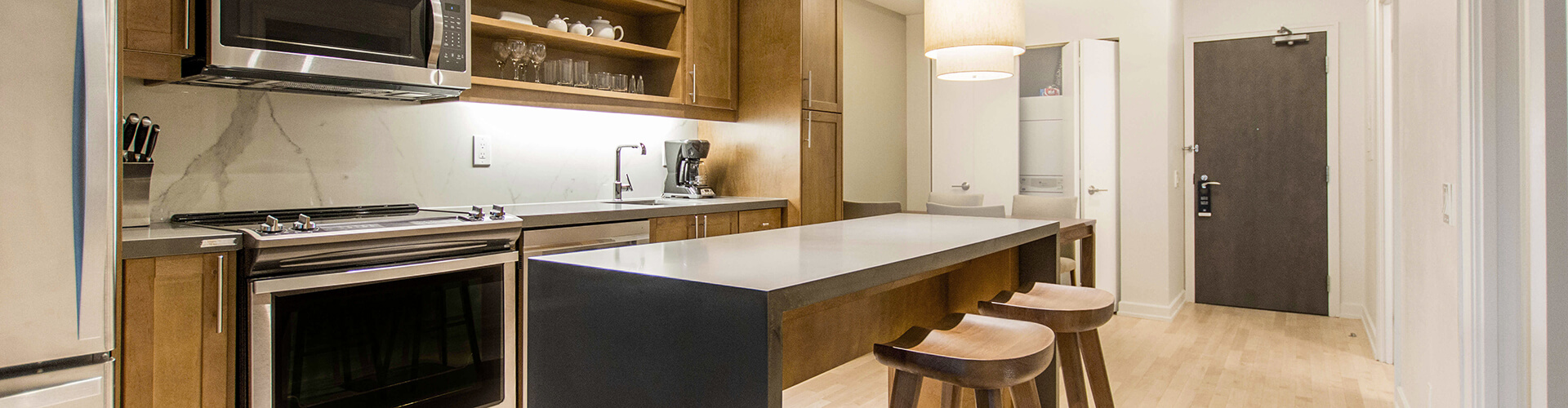 Modern kitchen at Yorkville Furnished Suite in Toronto. Rent with Minto Apartments.