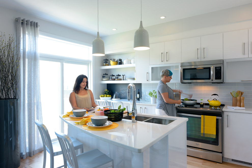 Couple enjoying new modern kitchen in Hyde, Minto Communities Ottawa