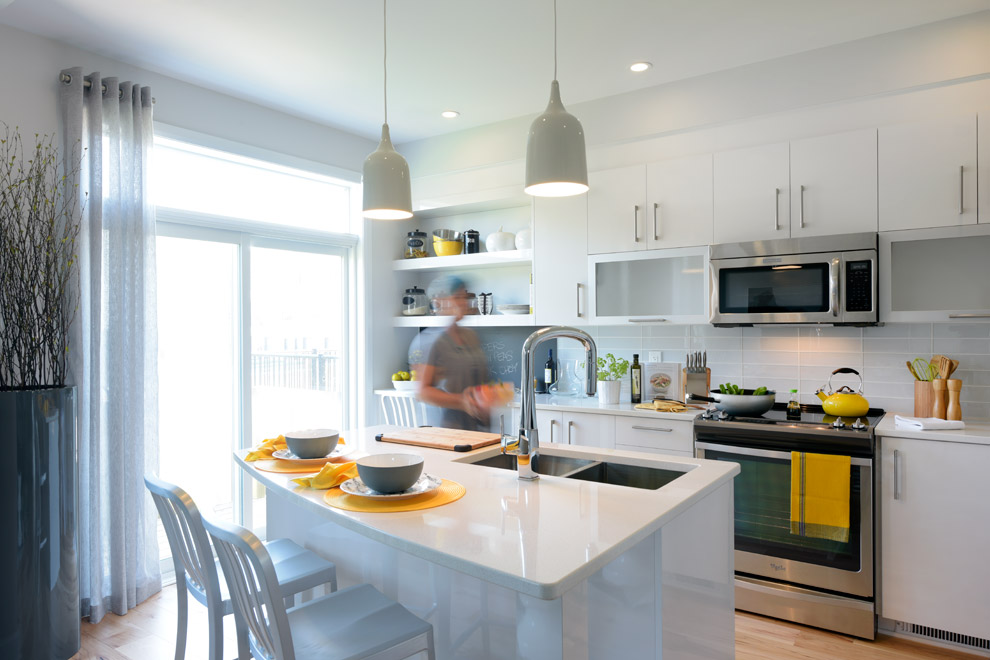 Woman cooking in spacious Hyde kitchen, Minto Communities Ottawa