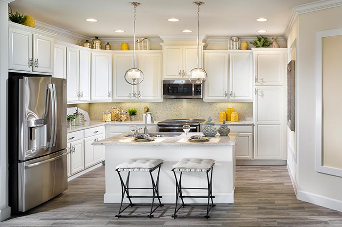 Luxury kitchen with center island and stainless steel appliances (Banyan Shown)