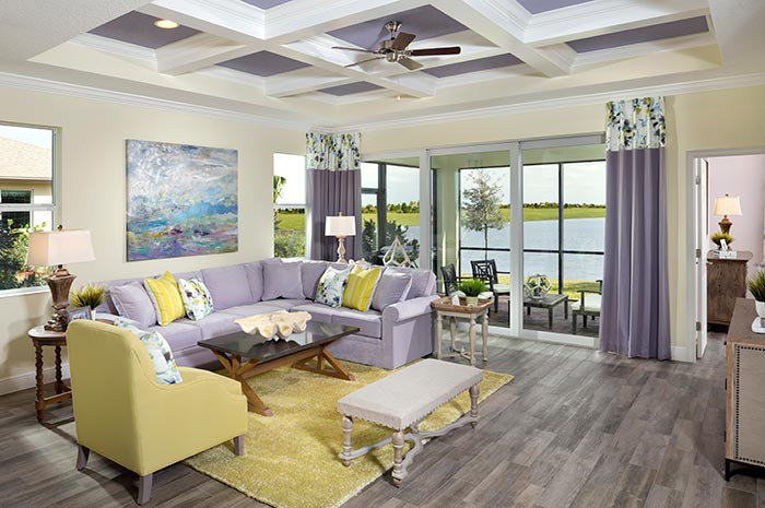 Living room with custom floors throughout and adjoining screened lanai (Buttonwood Shown)